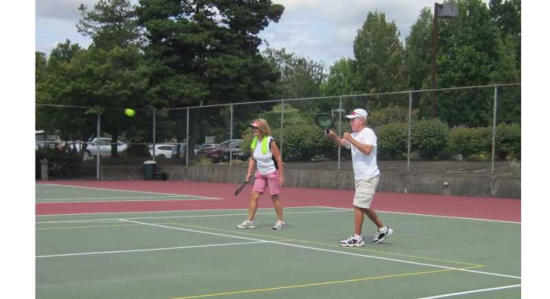 Photo Credit: BARBARA SHERMAN - KEEPING THAT BALL IN PLAY - Among the players having a good time on the Summerfield pickleball court, which is a modified tennis court, on Aug. 14 are Sheryl Caldwell and Del Jordan.