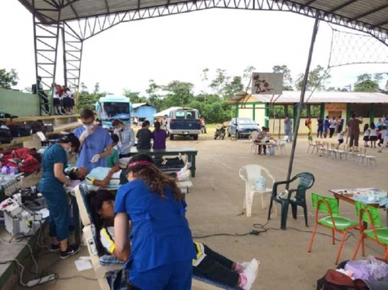 Photo Credit: COURTESY OF GREG WILLIAMS - RUGGED CONDITIONS -  A section of a street becomes a makeshift dental clinic as Wide Open Humanitarian team members work on patients under less-than-ideal conditions.