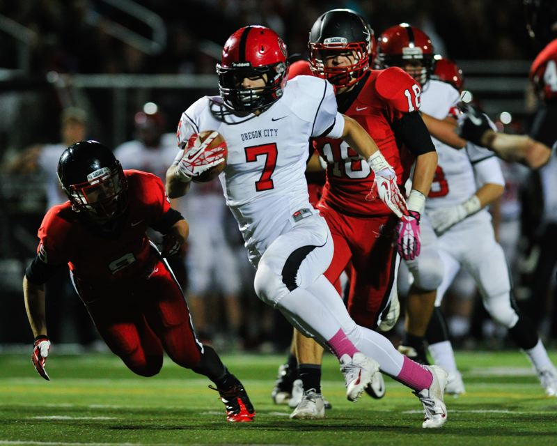Photo Credit: JOHN LARIVIERE - Conner Mitchell (7) breaks loose in last years win over Clackamas