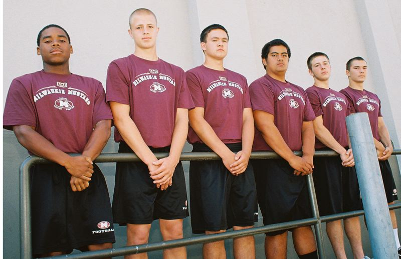 Photo Credit: JOHN DENNY - Milwaukie team captains (from left) Dre Edwards, Jonathan Snyder, Griffin Johnson, Tui Tuitele, Falcon Piner and River Meyer believe that the Mustangs will be much improved in football this year.