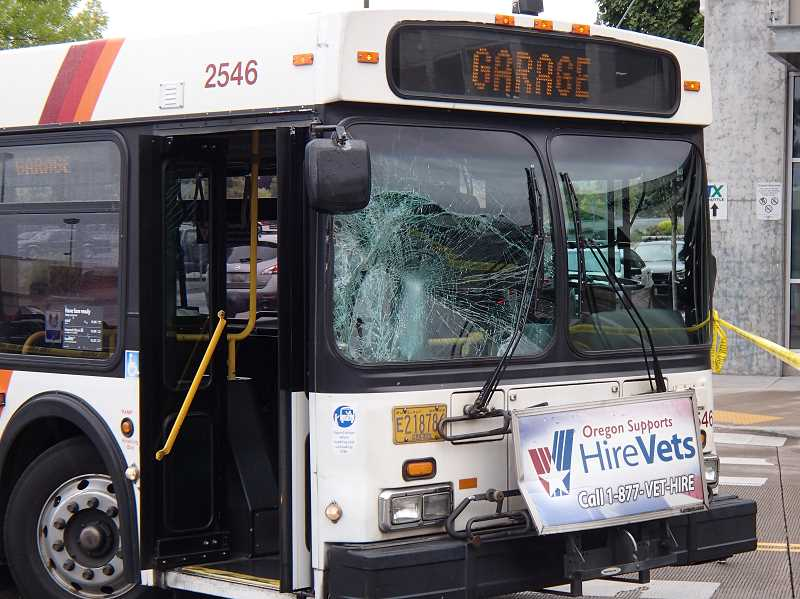 Photo Credit: SUBMITTED PHOTO - A TriMet bus suffered damage to its front passenger side after colliding with a pedestrian Saturday morning at Clackamas Town Center.