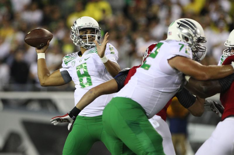 Photo Credit: TRIBUNE PHOTO: JAIME VALDEZ - Oregon quarterback Marcus Mariota gets time to uncork a pass against South Dakota.