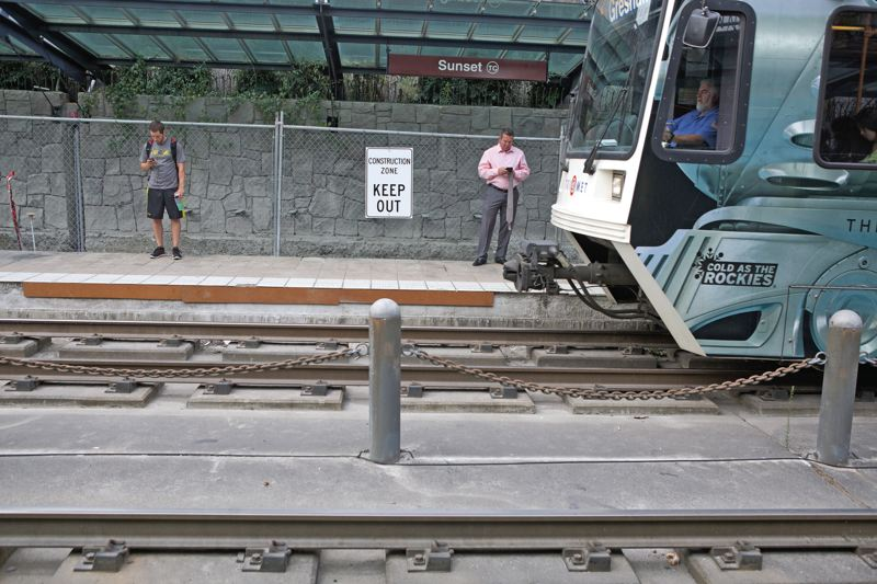 Photo Credit: TRIBUNE PHOTO JAIME VALDEZ - Failing tiles on the Sunset Transit Center MAX platform will be removed and replaced with concrete during the repair project.