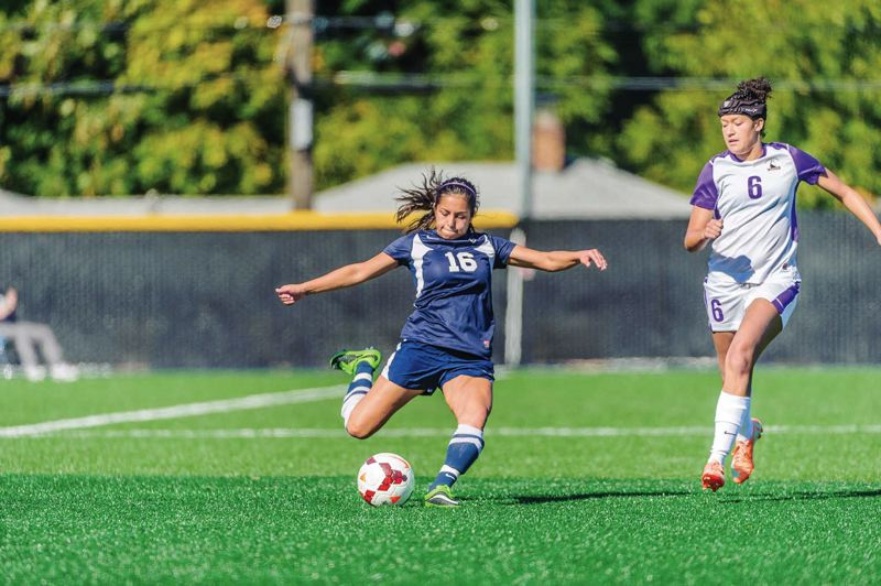 Photo Credit: COURTESY OF CONCORDIA UNIVERSITY - Jasmin Ayala (left) is back to help the Concordia Cavaliers try to sustain last years remarkable defensive play.