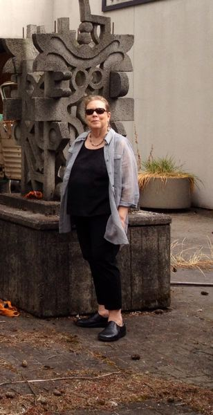 Photo Credit: SUBMITTED PHOTO - Multnomah neighbor Sharon Bronzan, with 'Abstract,' the concrete sculpture by artist Harold Balazs that she saved from demolition and arranged to have moved to a sculpture garden at Clackamas Community College.