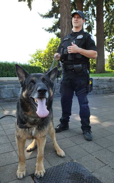 Photo Credit: REVIEW FILE PHOTO: VERN UYETAKE - As a team, Officer Bryan McMahon and Kai tracked down 87   people over the course of the dogs career, including four who were lost and endangered.