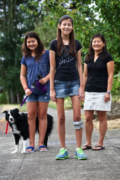 Photo Credit: TIMES PHOTO: JAIME VALDEZ - Nathalie Traller, 15, middle, stands next to her 13-year-old sister Kelley and her mother Vicki, who are members of her support group for the sixth annual Dragonslayer PDX Walk for Sarcoma at Cook Park in Tigard. Nathalie suffers from a rare form of cancer called Alveolar soft part sarcoma or ASPS.