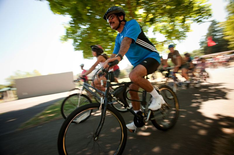 Photo Credit: TIME FILE PHOTO: CHRISTOPHER ONSTOTT - Families ride through Schiffler Park during Bike Beaverton.