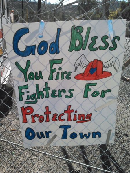 Photo Credit: PHOTO BY: JEFF SMITH - Residents of The Dalles express their support for the statewide effort to control the Rowena Fire, which included a large group from Clackamas County.