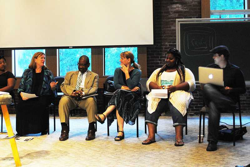 Photo Credit: NEWS-TIMES PHOTO: STEPHANIE HAUGEN - Panelists share their thoughts during a discussion about the Michael Brown shooting in Ferguson, Mo., Aug. 28 at Pacific University in Forest Grove.