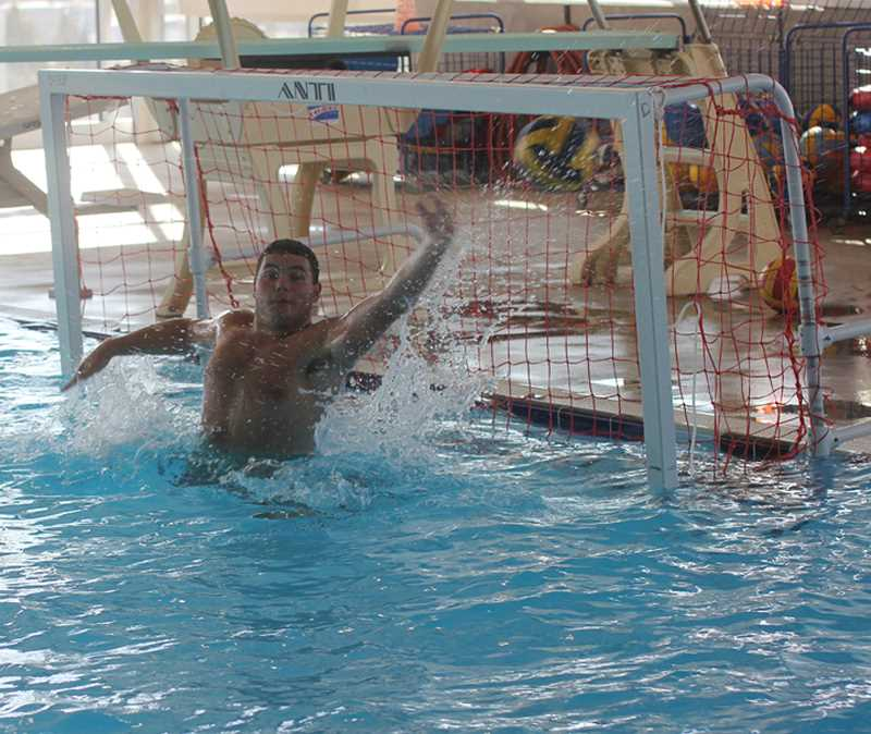 Photo Credit: JEFF WILSON/THE PIONEER - Senior Brady Tucker is back in the net for the Madras boys water polo team once again this year.