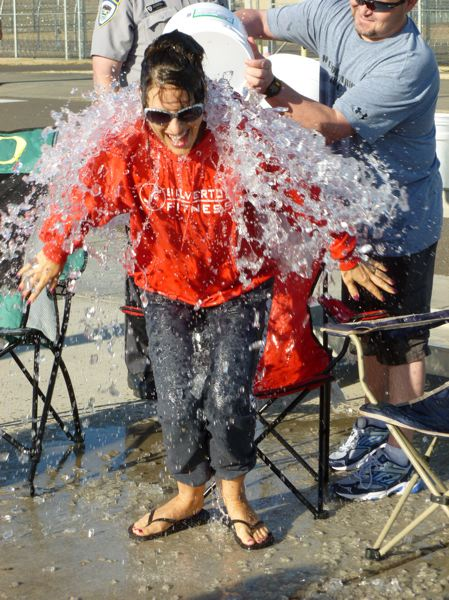 Photo Credit: SUBMITTED PHOTOS - Coffee Creek Correctional Facility Superintendent Heidi Steward takes the Ice Bucket Challenge on Aug. 8 outside the minimum security wing of Oregons only womens prison in Wilsonville.