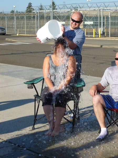 Photo Credit: SUBMITTED PHOTO - Coffee Creek Correctional Facility employee Amanda Mooney undergoes the Ice Bucket Challenge Aug. 8 outside the prisons minimum security wing.