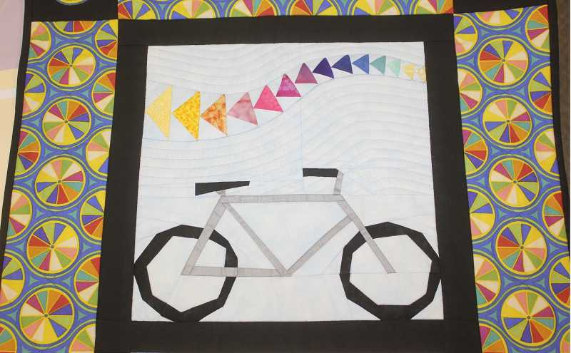 Photo Credit: SUSAN MATHENY/MADRAS PIONEER - A bicycle-themed quilt by Ruth Piaya is part of the show.