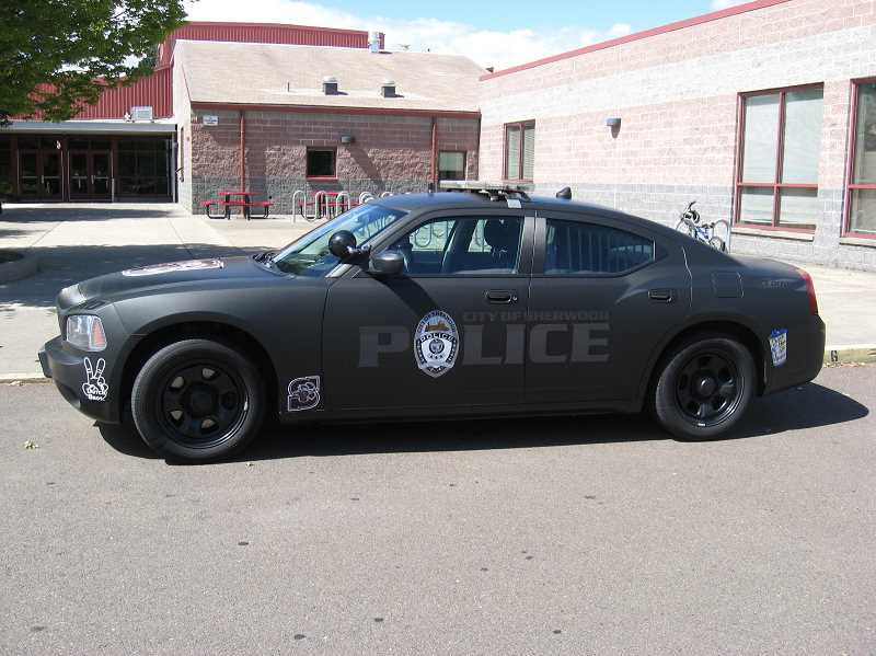 Photo Credit: SHERWOOD POLICE DEPARTMENT - The flashy new patrol car of SHS's school resource officer includes Dutch Bros. Coffee and SHS Bowman logos.