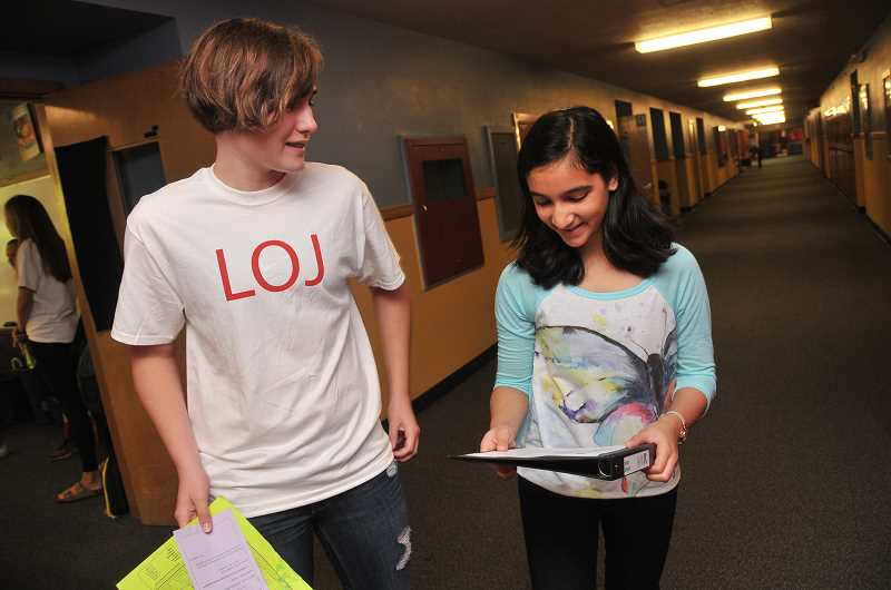 Photo Credit: REVIEW PHOTO: VERN UYETAKE - Alyssa Gustaff helps incoming sixth-grader Khushi Arora on the first day of classes at LOJHS.