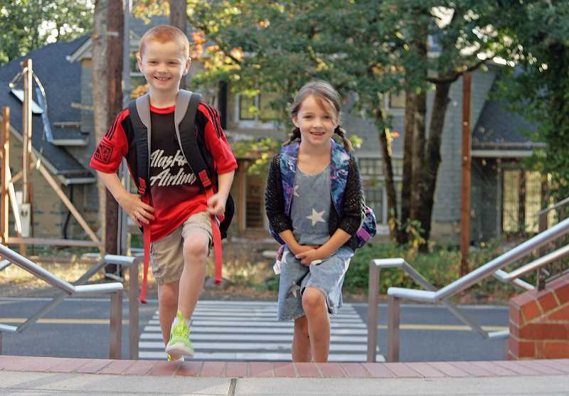 Photo Credit: SUBMITTED PHOTO: MARTIN DIXON - Second-graders Abigail and William Dixon walk up the steps to Riverdale Grade School on the first day this week.