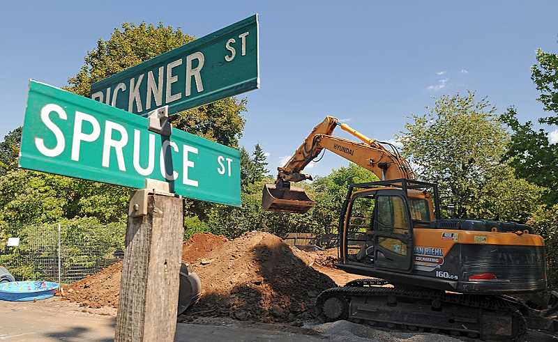 Photo Credit: REVIEW PHOTO: VERN UYETAKE - Construction has already started on a 2,600-square-foot home at  1287 Bickner St. Sixteen new homes are planned in a reedevelopment project that has created controversy in the Hallinan Heights neighborhood.