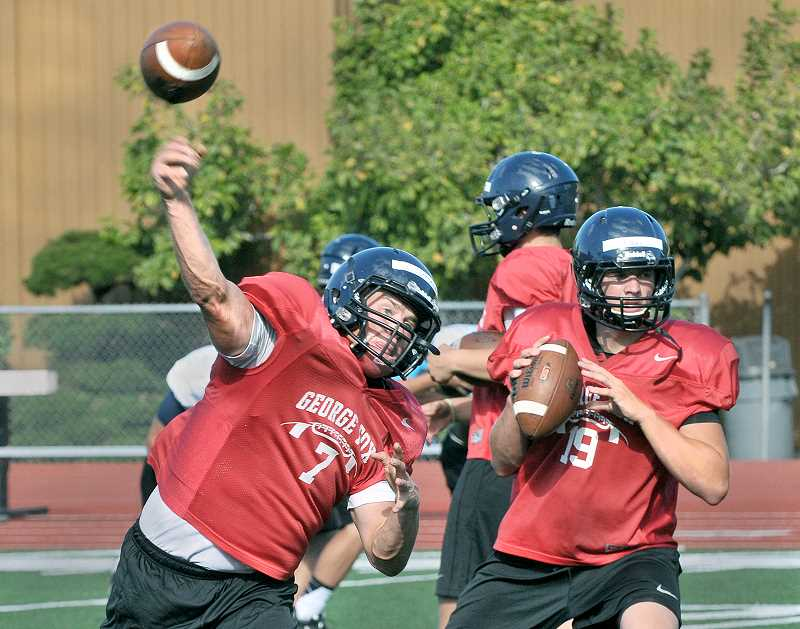 Photo Credit: SETH GORDON - Hurler - Starting quarterback Grant Schroeder flings a pass during practice last week. The Santiam Christian graduate will lead the George Fox offense when the Bruins open their first season of football in 46 years Saturday versus Arizona Christian.
