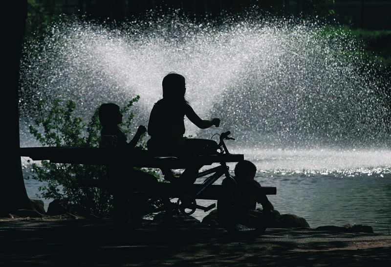 Photo Credit: PAMPLIN MEDIA GROUP FILE PHOTO: JIM CLARK - Children take advantage of the spray at Red Sunset Park to stay cool this summer. The Portland area has seen more 90-degree days this summer than in the past.