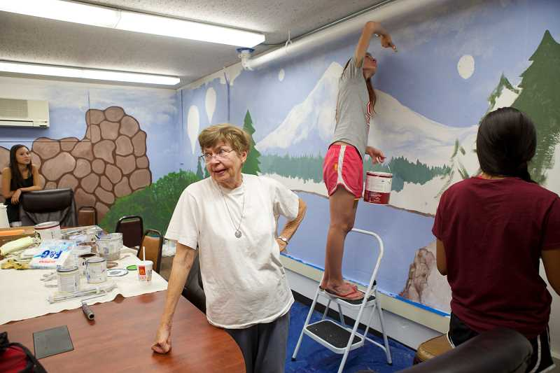 Photo Credit: TIMES PHOTO: JAIME VALDEZ - Elizabeth Cvetic has been painting for 60 years, and said that the large mural in the Tigard Senior Center has already brought new energy to the space. The room was previously called the dungeon.