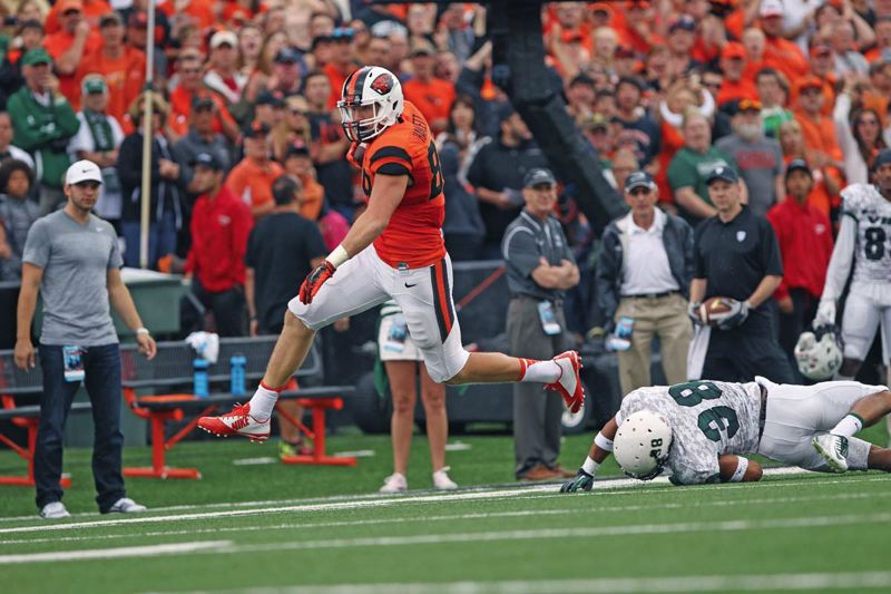 Photo Credit: TRIBUNE PHOTO: JAIME VALDEZ - Tight end Connor Hamlett pulls away from Portland State for yardage in last week's Oregon State season opener. The Beavers will be looking for better offensive efficiency Saturday at Hawaii, which nearly upset Washington in its opener.