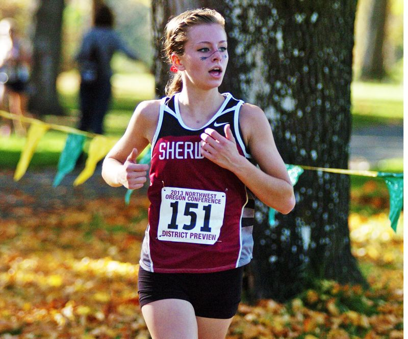 Photo Credit: DAN BROOD - BACK AND RUNNING STRONG -- Senior Madison Budge, shown here at last year's NWOC district meet, could be one of the leaders for the Lady Bowmen cross country team this season.