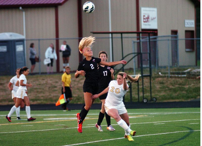 Photo Credit: DAN BROOD - WAY UP HIGH -- Sherwood High School sophomore Kaillen Fried (left) heads the ball above Southridge's Kelsey Beber in Tuesday's game. Fried scored the Lady Bowmen's first goal in the 2-2 tie.