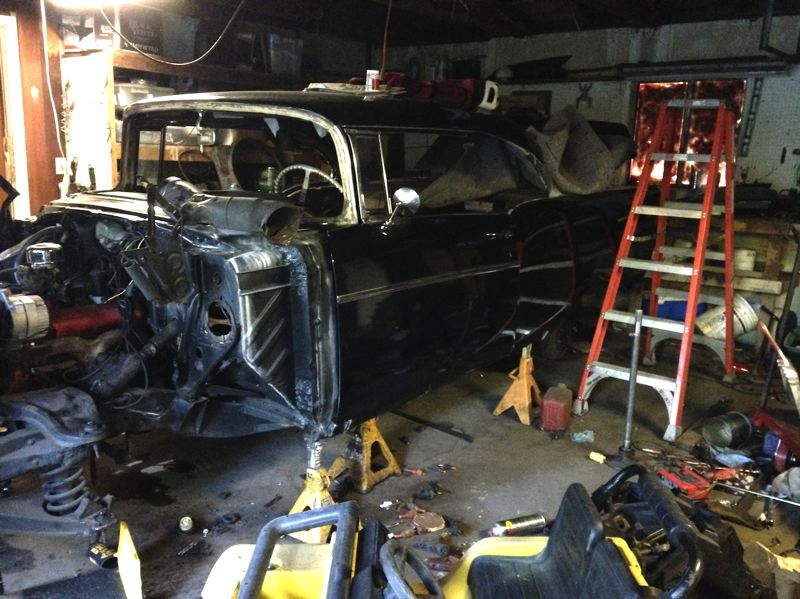 Photo Credit: CONTRIBUTED: CLACKAMAS COUNTY SHERIFF'S OFFICE - Gresham police and Clackamas County Sheriff's deputies raided a 'chop shop' in Boring where several stolen vehicles, including this stripped down 1957 Chevrolet were found. Several people are being questioned and more details will be released later.