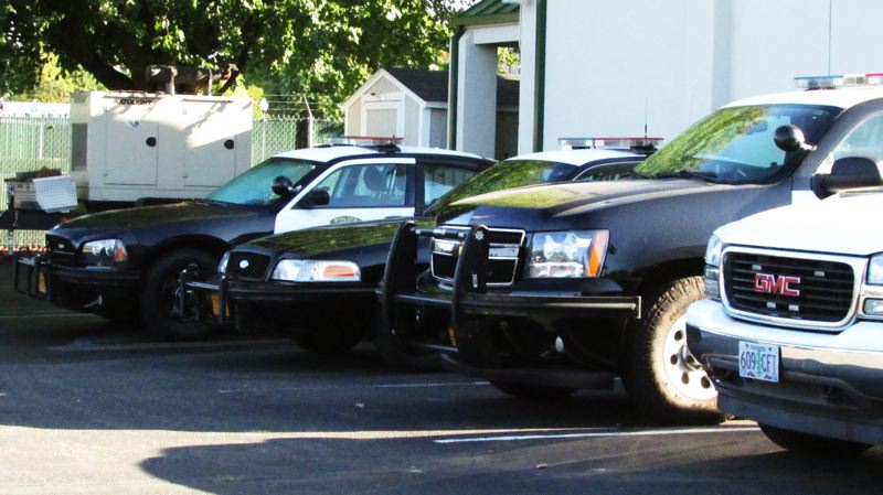 Photo Credit: COURTNEY VAUGHN - Police vehicles at the Scappoose police station show a variety of makes and models in use. The Scappoose City Council voted Tuesday to purchase four new Dodge Charger patrol vehicles.