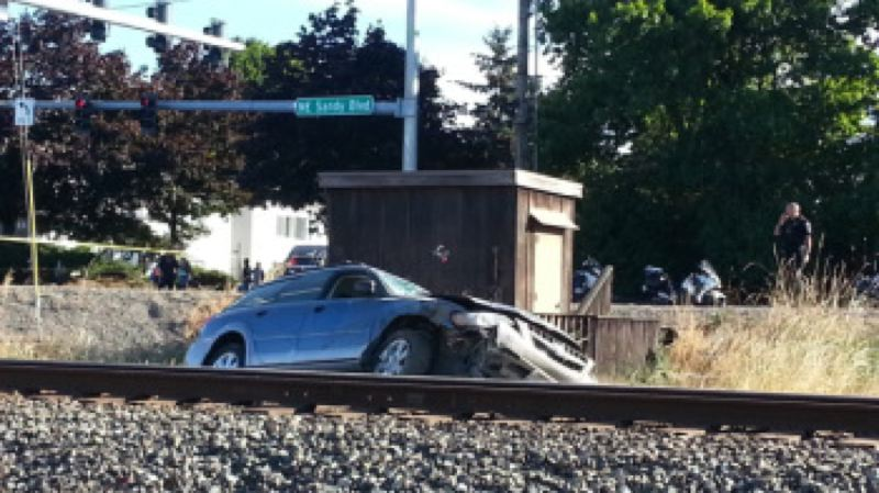 Photo Credit: KOIN 6 NEWS/ELLEN HANSEN - One person died when the driver of this car lost control at Northeast Sandy around 122nd Avenue on Sept. 4.