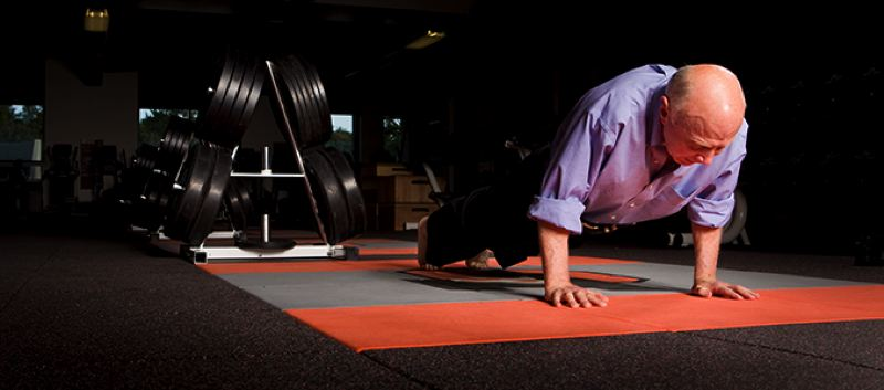 Photo Credit: COURTESY OF LEWIS & CLARK COLLEGE - Portland businessman and philanthropist Robert Pamplin Jr. is challenging Lewis & Clark College students to beat his push-up and pull-up numbers. The challenge is part of the college's Pioneer Fair Friday afternoon on the Southwest Portland campus.