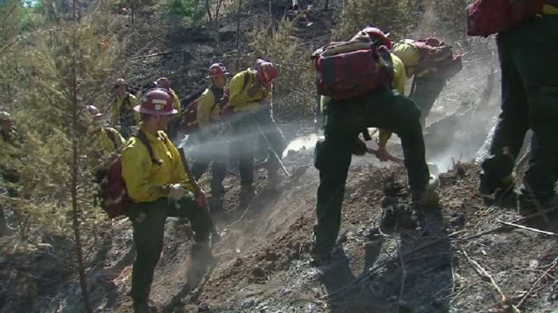 Photo Credit: COURTESY PHOTO: KOIN 6 NEWS - About 600 firefighters battled the Scoggins Creek Fire near Hagg Lake Sunday afternoon, digging a fire line around its perimeter.