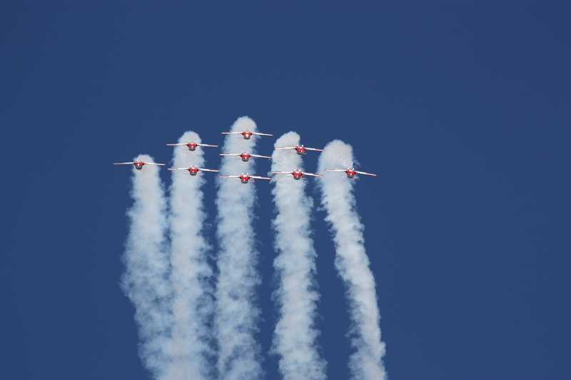 Photo Credit: NEWS-TIMES PHOTOS: DOUG BURKHARDT - A team of nine jets from the Royal Canadian Air Force put on a precision flying display at the Oregon International Air Show. The Snowbirds Jet Team were this years headliner.