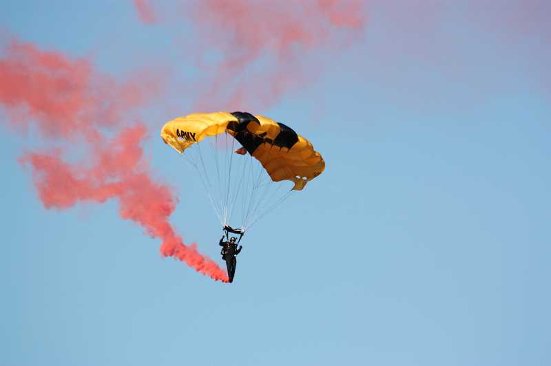 Members of the U.S. Army Golden Knights parachute team kicked off the early action Saturday and Sunday by jumping from a plane at 10,000 feet and, one by one, landing on a target on the airfield that was just a few feet wide.