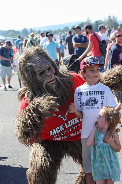 Even Sasquatch wanted to see the air show so badly that he risked coming out from the forest to enjoy the days festivities. Here, he surprises some kids in the crowd at the show.