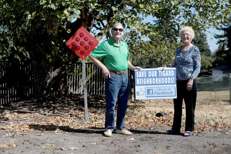 Photo Credit: TIMES PHOTO: JONATHAN HOUSE - Don and Mary Feller are leading a charge to stop a planned extension of their street for new development. Neighbors have hired an attorney and plan to fight the city if the plans go through.