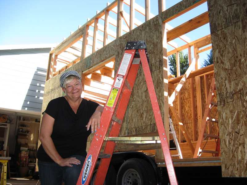 Photo Credit: GAZETTE PHOTO BY RAY PITZ - Michelle Boyle is building a 'tiny house' she says is both ecologically sound ans will provide a nice dwelling for her retirement.