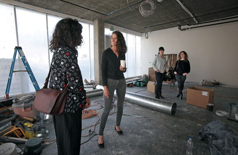 Photo Credit: TRIBUNE PHOTO: JONATHAN HOUSE - Fieldwork Flowers Megan Arambul chats with Nationales Gabi Lewton-Leopold in the flower shops new spot. Along with Adorn boutique, the three businesses will hold grand openings this month.