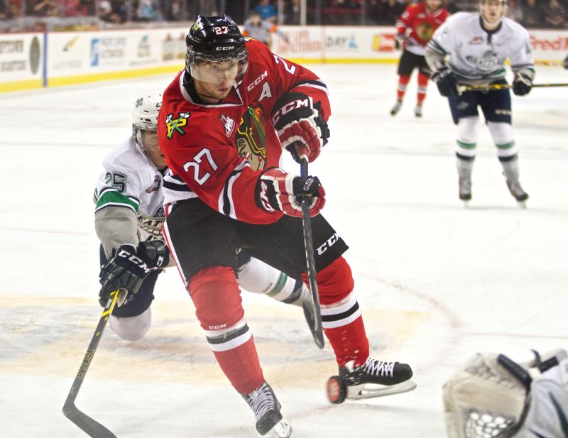 Photo Credit: TRIBUNE PHOTO: JAIME VALDEZ - Portland Winterhawks right wing Oliver Bjorkstrand scores the Hawks' first goal against Seattle in the first period Saturday night at Moda Center.