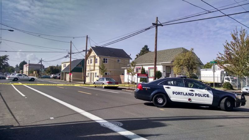 Photo Credit: KOIN 6 NEWS - Portland police investigate a stabbing in the 8500 block of Southeast Woodstock.