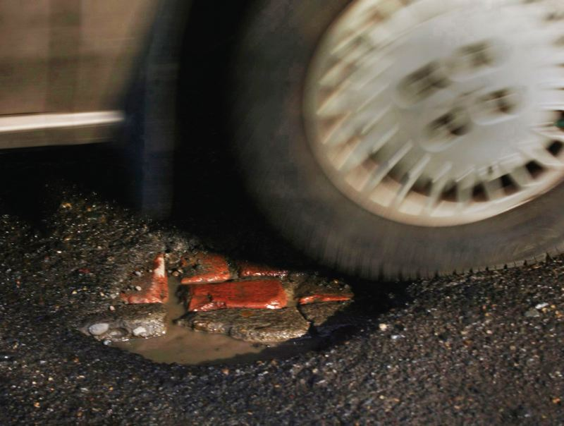 Photo Credit: TRIBUNE FILE PHOTO - A new street fee proposal could get a City Council vote in November. The plan would fund projects to repair potholed city streets and make some safety improvements in high-traffic areas.