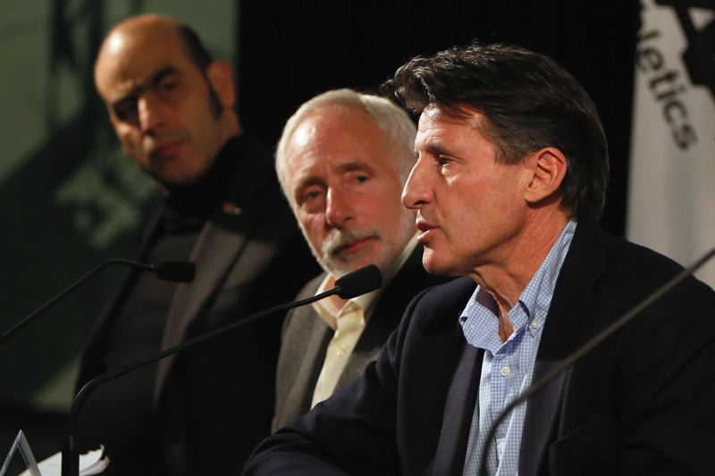 Photo Credit: COURTESY OF ANDY NELSON/THE REGISTER-GUARD - IAAF Vice-President Sebastian Coe (right) talks Monday in Eugene about the bid to bring the 2019 track and field world championships to Hayward Field, as Track Town USA President Vin Lananna (center) and IAAF General Secretary Essar Gabriel listen at the press conference.