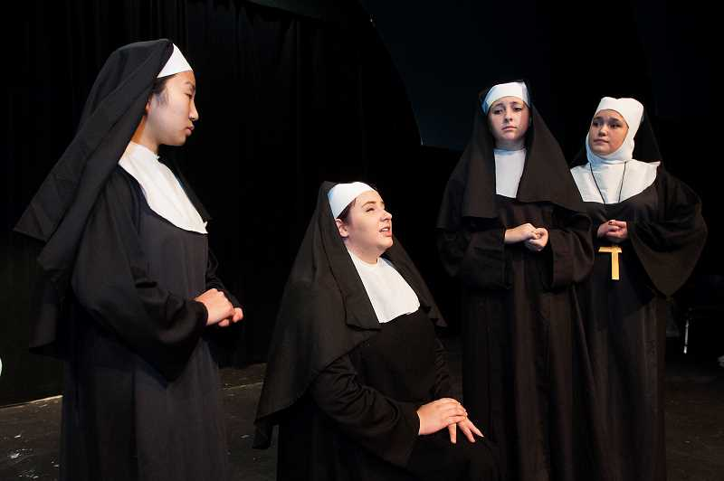 Photo Credit: SPOKESMAN PHOTO: JOSH KULLA - From right, seniors Angela Garreltt, Aubrey Slaughter and Ellie Lauthner join sophomore Kylee Kamikawa as nuns in Wilsnoville High Schools production of The Sound of Music.