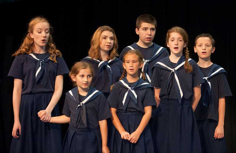 Photo Credit: SPOKESMAN PHOTO: JOSH KULLA - A group of young actors from Wilsonville primary, middle and high schools portray Von Trapp children in the play.
