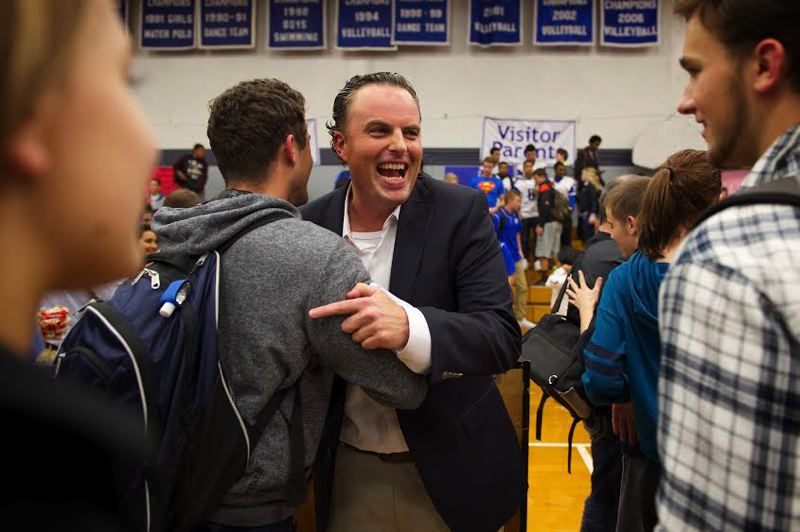 Photo Credit: OUTLOOK PHOTO: TROY WAYRYNEN - Michael Lindblad, a Gresham High School social studies teacher, receives congratulations from students after he was named the 2015 Oregon Teacher of the Year.