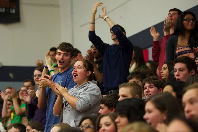 Photo Credit: OUTLOOK PHOTO: TROY WAYRYNEN - Students cheer for Michael Lindblad, a Gresham High School social studies teacher, during an assembly as Lindblad is named the 2015 Oregon Teacher of the Year.