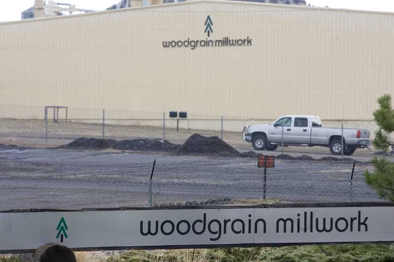 Photo Credit: KEVIN SPERL - Woodgrain Millwork, shown above, laid off more than 200 of its employees in response to a roof collapse that damaged vital machinery.