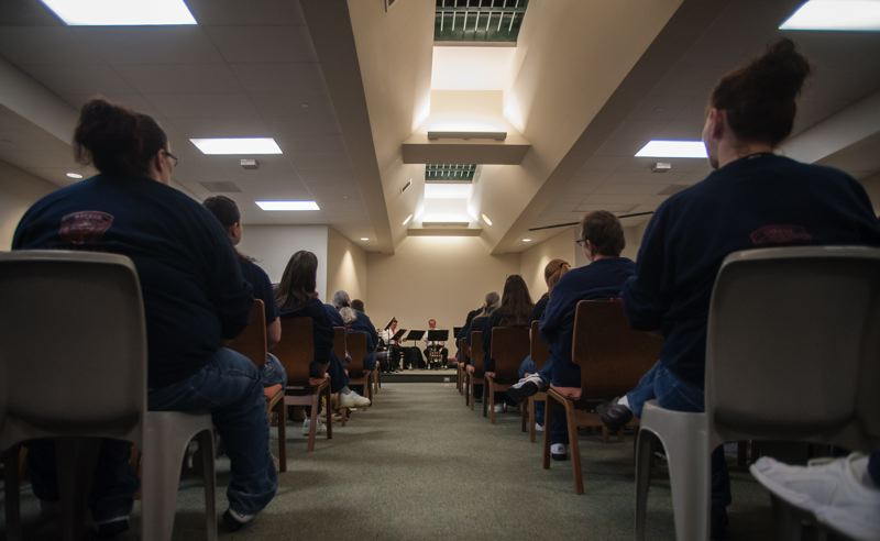 Photo Credit: SPOKESMAN PHOTO: JOSH KULLA - Coffee Creek Correctional Facility inmates packed the prison's chapel Dec. 9 for a special holiday concert by an Oregon Symphony quintet.