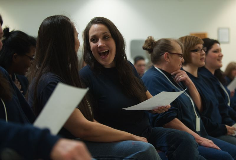 Photo Credit: SPOKESMAN PHOTO: JOSH KULLA - Coffee Creek Correctional Facility inmates (L-R front row) Amanda Stott-Smith, Pam Rowely- Butcher, Tara Davies, Joana Underhill and Niela Shamsid-deen sing along to Christmas tunes performed by an Oregon Symphony quintet Dec. 9.